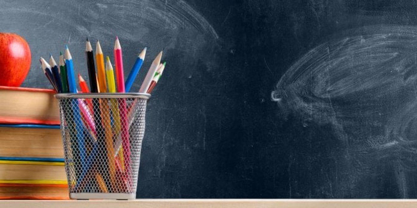 School accessories against blackboard